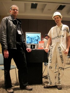 "Rob Wittig and curatorial intern Greg Philbrook with the Invisible Seattle exhibit at the ""Electronic Literature"" exhibit, Modern Language Association 2012 conference in Seattle."